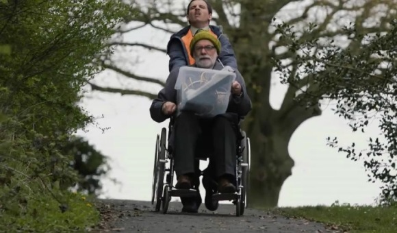 Billy pushes Jack on wheelchair
