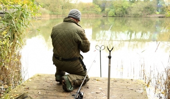 Fishing lake Adam Evans walks checks lake